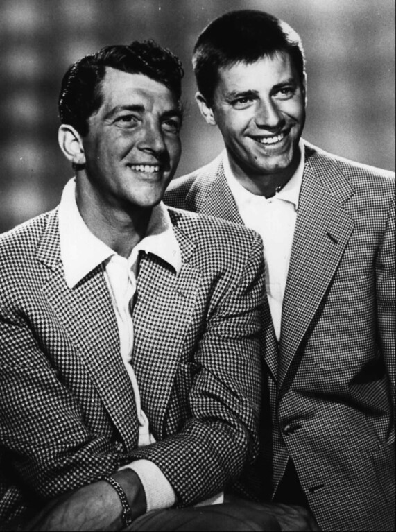 """. FILE - Dean Martin, left, and Jerry Lewis pose for the \""""Colgate Comedy Hour\"""" Aug. 27, 1954.   (AP Photo, files)"""