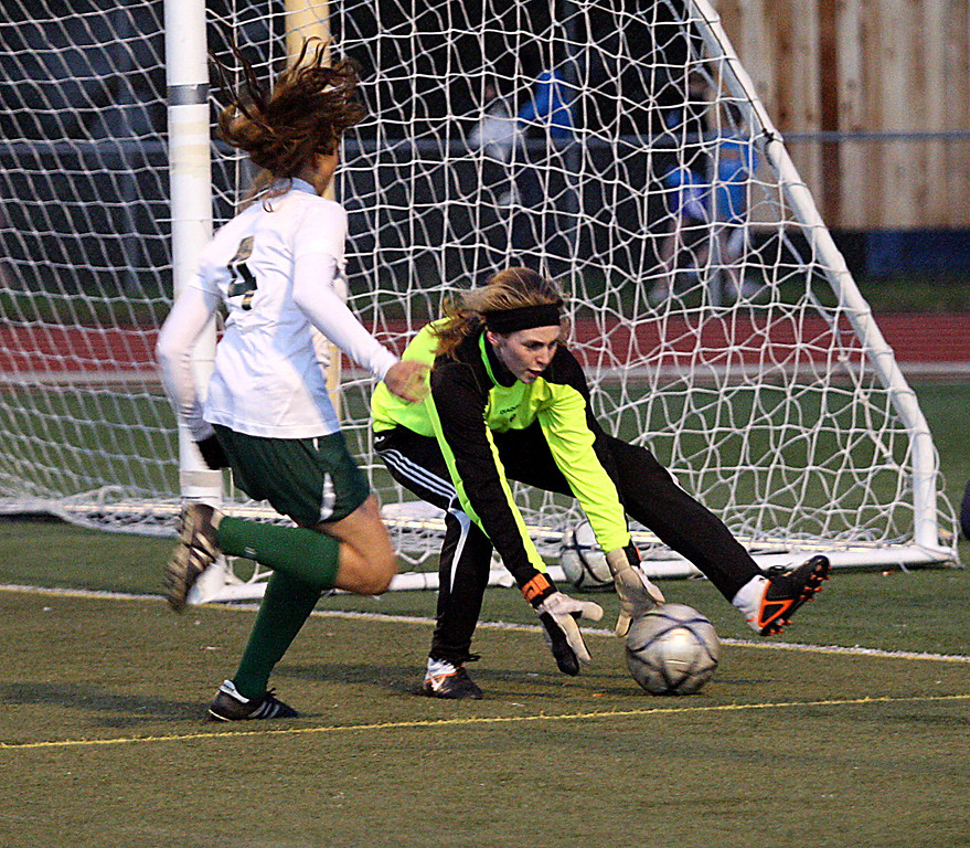 """. Pacific Collegiate School\'s goal keeper Nicole Trenchard makes a save before being bowled over by Harbor\'s Ellie Loustalot early in their Central Coast Section D-III girls soccer match Wednesday, Feb. 20, 2013, at Soquel High in Soquel, Calif. Harbor won 2-0. <a href=\""""http://www.santacruzsentinel.com/sports/ci_22633905\"""">Read more.</a> (Dan Coyro/Sentinel)"""