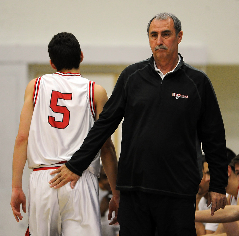 . Glendora head coach Michael LeDuc with Thomas Rico (C) (5) in the first half of a prep basketball game against California during the SoCal Shootout in the Felix Event Center on the west campus of Azusa Pacific University in Azusa, Calif., on Saturday, Jan. 18, 2014. (Keith Birmingham Pasadena Star-News)