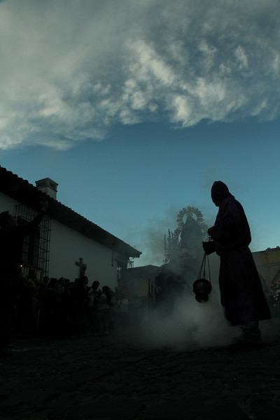 A man waves incense ahead of a long line of processioners making their way through the streets of Antigua, Guatemala on February 17, 2013 in celebration of Lent. Photo by Scott Umstattd