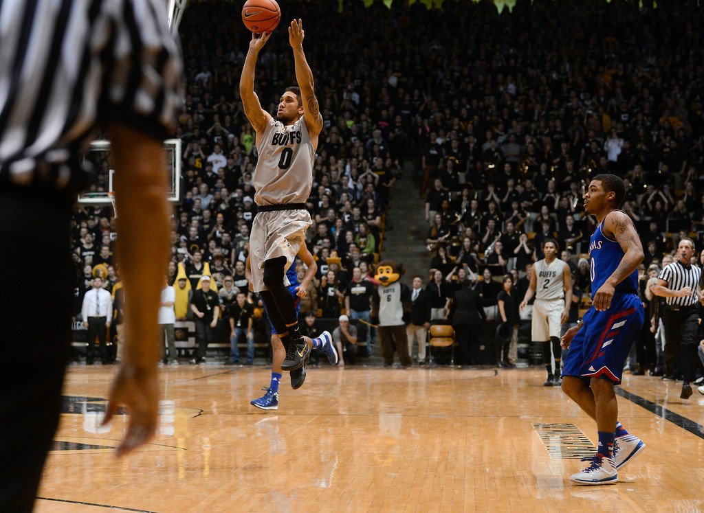 . Colorado University guard, Askia Booker, hits a three-pointer on the last shot of the game to win against Frank Mason and the Kansas Jayhawks 75-72 at the Coors Events Center in Boulder Colorado Saturday afternoon, December 07, 2013. Kansas point guard, Askia Booker, right, could only watch. (Photo By Andy Cross/The Denver Post)
