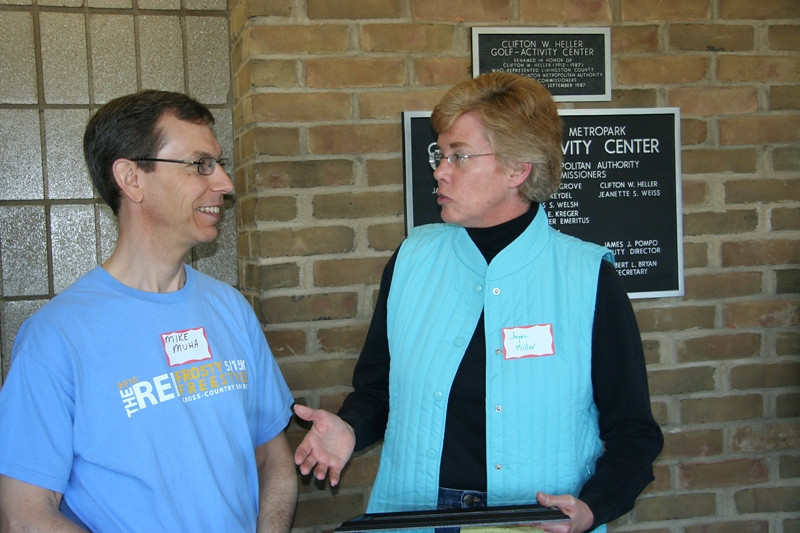 Mike Muha is honored as the Huron-Clinton Metroparks Volunteer of the Year by Metroparks Director Jayne Miller.