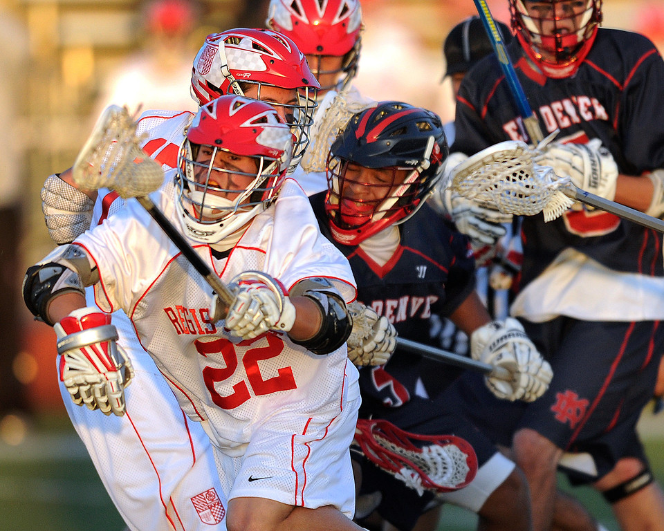 . AURORA, CO. - APRIL 24:  Regis Jesuit sophomore Ben Bechter (22) came away with a loose ball in the first half. The Regis Jesuit High School boy\'s lacrosse team defeated Kent Denver 10-8 Wednesday night, April 24, 2013. Photo By Karl Gehring/The Denver Post