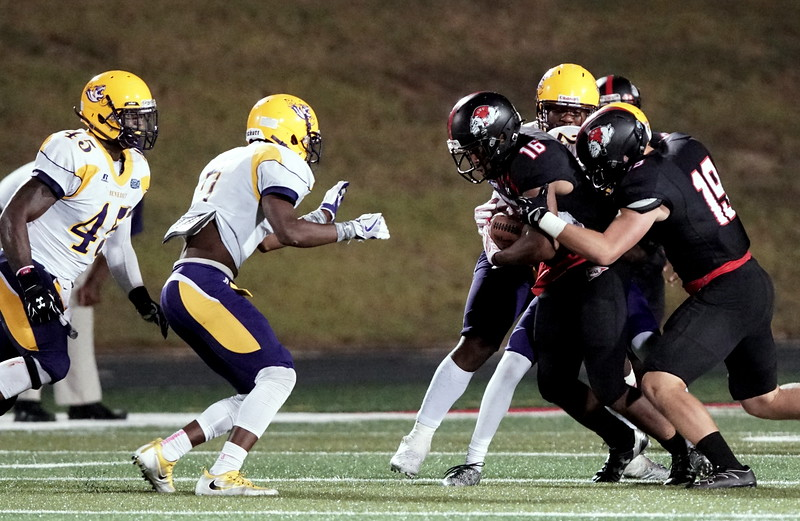 Willie Jackson IV runs into a Benedict tackle. -Taken by Ashley Falls
