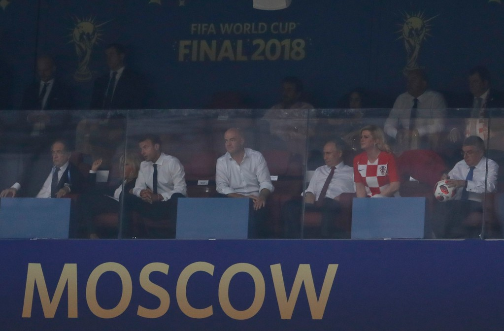 . French President Emannuel Macron, 3rd from left, FIFA President Gianni Infantino, Russian President Vladimir Putin and Croatian President Kolinda Grabar-Kitarovic in the stands prior to during the final match between France and Croatia at the 2018 soccer World Cup in the Luzhniki Stadium in Moscow, Russia, Sunday, July 15, 2018. (AP Photo/Petr David Josek)