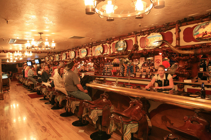 """The """"Million Dollar Bar"""" in Jackson Hole.  Take a look at the barstools."""
