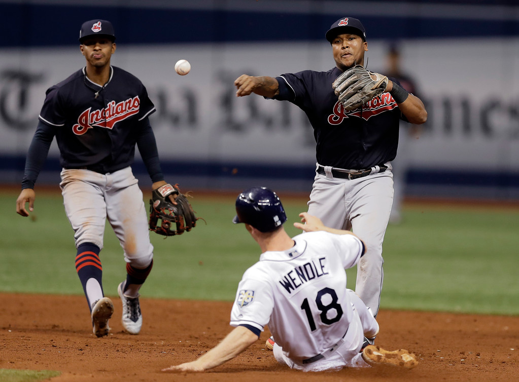 . Cleveland Indians second baseman Jose Ramirez forces Tampa Bay Rays\' Joey Wendle (18) at second base on a fielder\'s choice by Willy Adames during the ninth inning of a baseball game, Tuesday, Sept. 11, 2018, in St. Petersburg, Fla. Looking on is shortstop Francisco Lindor. (AP Photo/Chris O\'Meara)