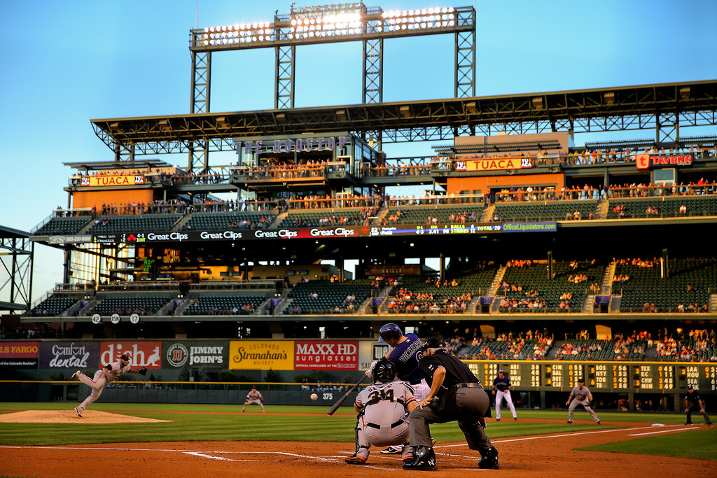 . DENVER, CO - SEPTEMBER 2:  Corey Dickerson #6 of the Colorado Rockies hits an RBI double off of starting pitcher Yusmeiro Petit #52 of the San Francisco Giants during the first inning at Coors Field on September 2, 2014 in Denver, Colorado. (Photo by Justin Edmonds/Getty Images)