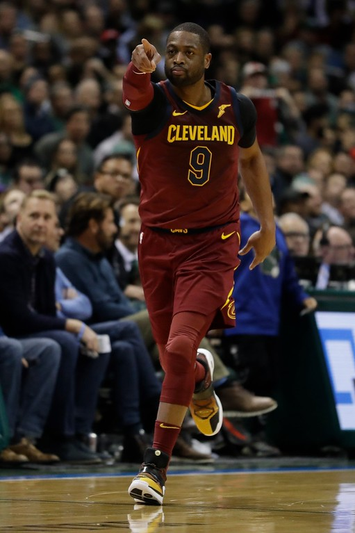 . Cleveland Cavaliers\' Dwyane Wade reacts after making a three-point basket during the second half of an NBA basketball game against the Milwaukee Bucks Tuesday, Dec. 19, 2017, in Milwaukee. The Bucks won 119-116. (AP Photo/Morry Gash)