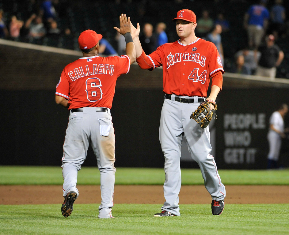 . CHICAGO, IL - JULY 10: Mark Trumbo #44 of the Los Angeles Angels of Anaheim and Alberto Callaspo #6  celebrate their win against the Chicago Cubs on July 10, 2013 at Wrigley Field in Chicago, Illinois. The Los Angeles Angels of Anaheim defeated the Chicago Cubs 13-2. (Photo by David Banks/Getty Images)