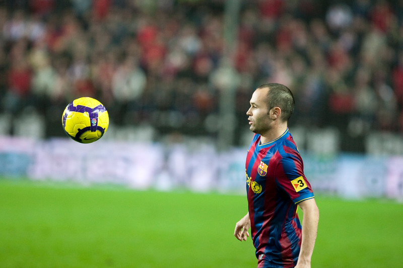 Andres Iniesta looking at the ball. Spanish Cup game between Sevilla FC and FC Barcelona, Ramon Sanchez Pizjuan stadium, Seville, Spain, 13 January 2010