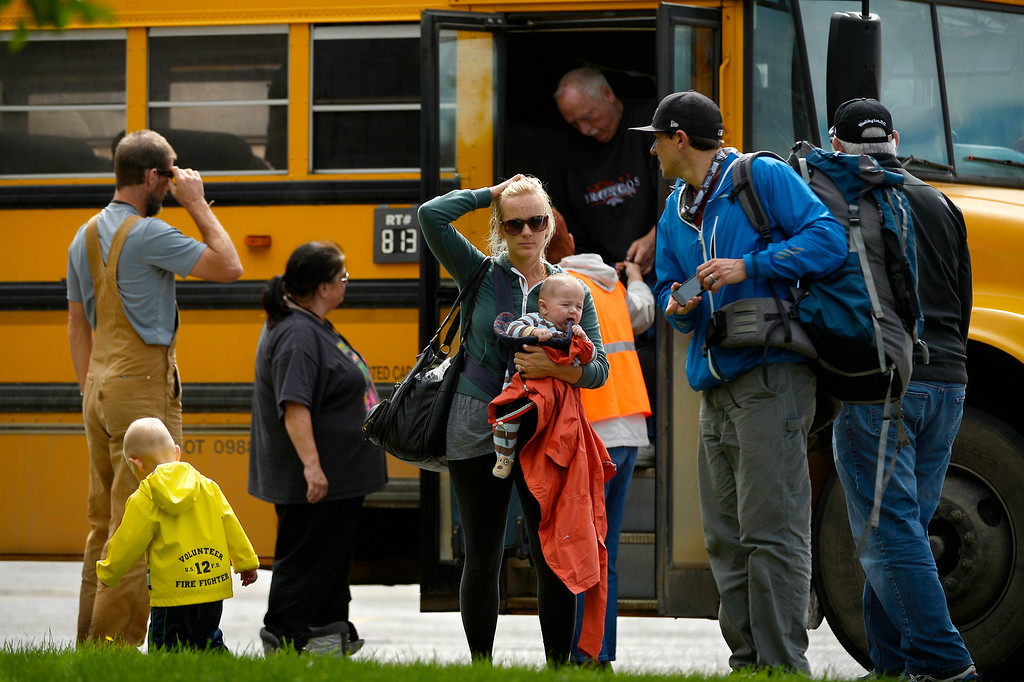 . Tired and disoriented rescued residents of Lyons get off the bus  at the LifeBridge Christian Church in Longmont September 13, 2013 Longmont, Colorado. (Photo By Joe Amon/The Denver Post)