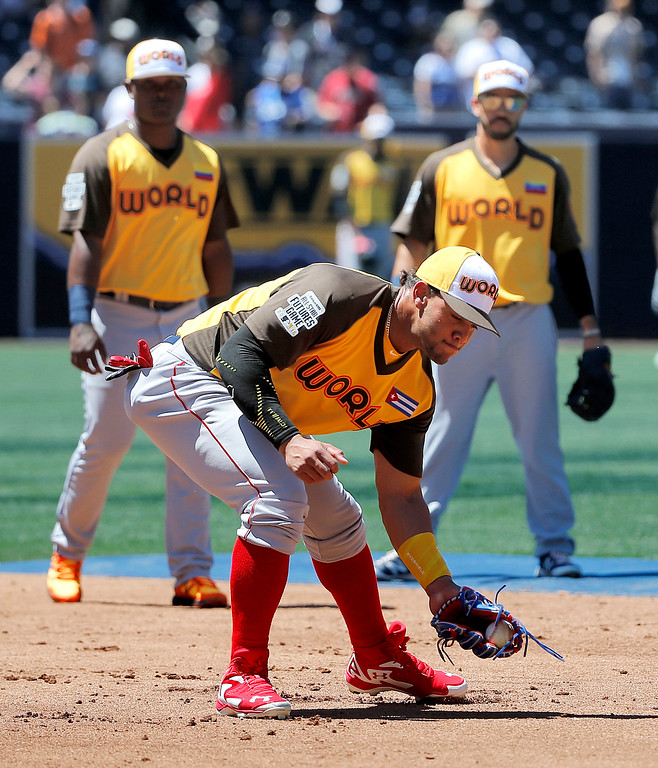 . World Team\'s Yoan Moncada, of the Boston Red Sox, fields prior to the All-Star Futures baseball game against the U.S. Team, Sunday, July 10, 2016, in San Diego. (AP Photo/Lenny Ignelzi)