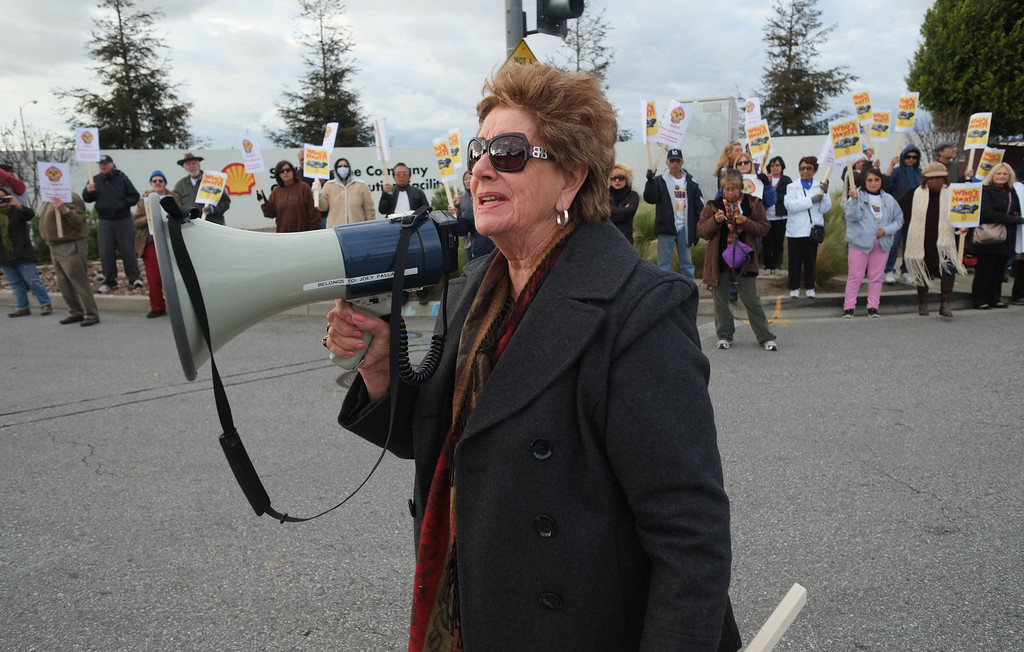. Residents of the Carousel Tract neighborhood in Carson staged a protest against Shell Oil Friday by marching with signs from Dolphin Park to a Shell facility on Wilmington Avenue. Carousel Neighbors Association President Barbara Post speaks during the protest. 20130308 Photo by Steve McCrank / Staff Photographer
