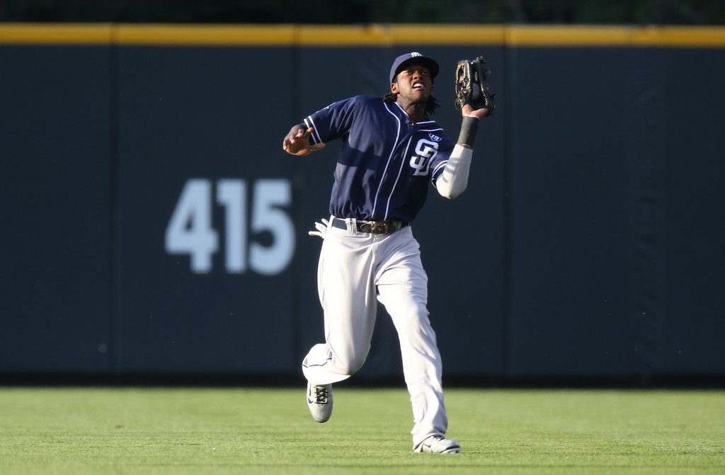 . San Diego Padres center fielder Cameron Maybin pulls in fly ball off the bat of Colorado Rockies\' Charlie Blackmon in the first inning of a baseball game in Denver on Saturday, Sept. 6, 2014. (AP Photo/David Zalubowski)