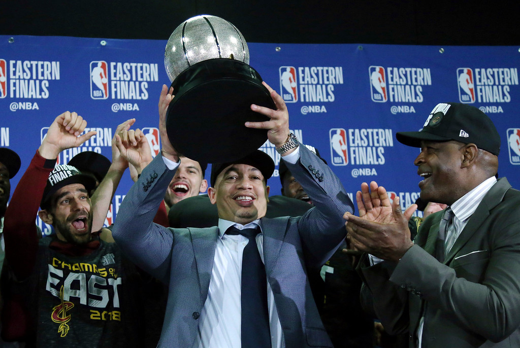 . Cleveland Cavaliers head coach Tyronn Lue hoists the trophy after beating the Boston Celtics 87-79 in Game 7 of the NBA basketball Eastern Conference finals, Sunday, May 27, 2018, in Boston. (AP Photo/Elise Amendola)