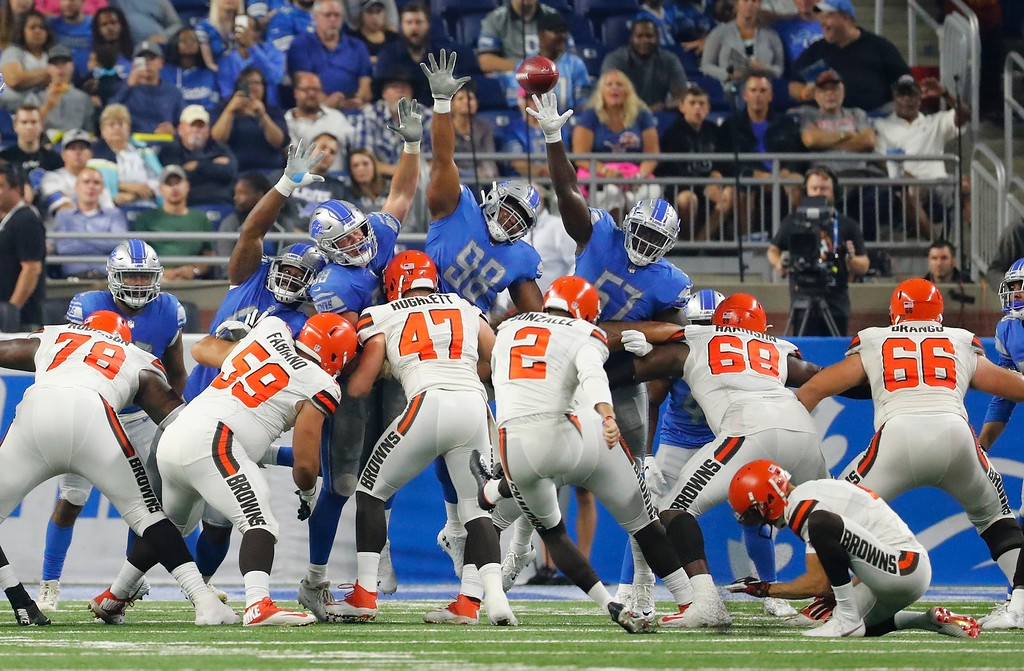 . The Detroit Lions defensive line jumps as they try a block of Cleveland Browns Zane Gonzalez\'s extra point during the first half of an NFL football preseason game, Thursday, Aug. 30, 2018, in Detroit. (AP Photo/Rick Osentoski)