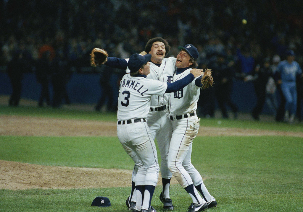 . Detroits Alan Trammell, left, Willie Hernandez and Darrell Evans, right, celebrate after they beat the Kansas City Royals 1-0 to win the AL Championship, Friday, Oct. 5, 1984, Detroit, Mich. (AP Photo/Mark Duncan)