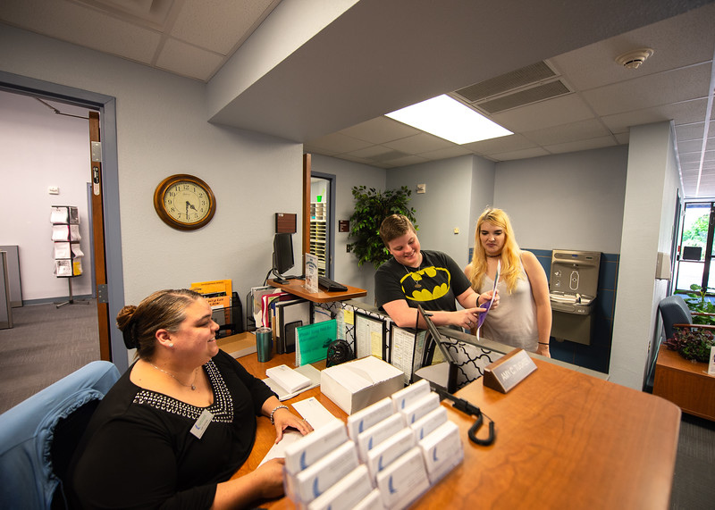 Brielle Duchesneau (far right) and Taylor Pilgreen stop by the front desk of the Center for Academic Achievement to ask Amy Tucker about tutor services for the summer terms.  Click here http://bit.ly/1hswXLM for more information about the Center for Academic Student Achievement (CASA).