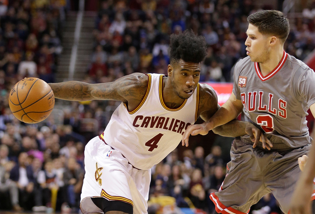 . Cleveland Cavaliers\' Iman Shumpert (4) drives past Chicago Bulls\' Doug McDermott (3) in the first half of an NBA basketball game Saturday, Jan. 23, 2016, in Cleveland. The Bulls won 96-83. (AP Photo/Tony Dejak)