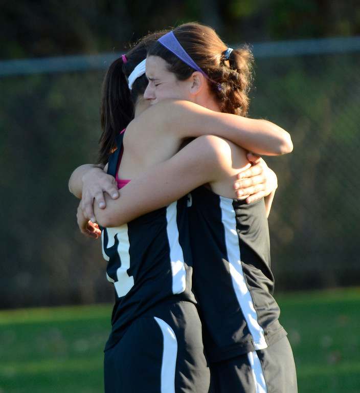 . Ed Burke - the Saratogian 10/29/13 Glens Falls varsity field hockey players console each other Tuesday after their Class B semi-final loss to cross-river rivals South High.