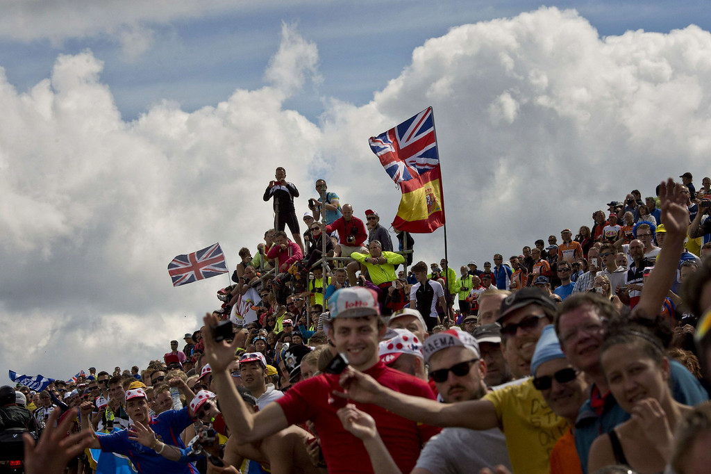 . Supporters are pictured along the road during the 201 km second stage of the 101th edition of the Tour de France cycling race on July 6, 2014 between York and Sheffield, northern England.  AFP PHOTO / JEFF PACHOUDJEFF PACHOUD/AFP/Getty Images