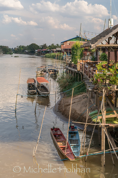 Boats and houses along the Mekong River in Don Dhet, Laos