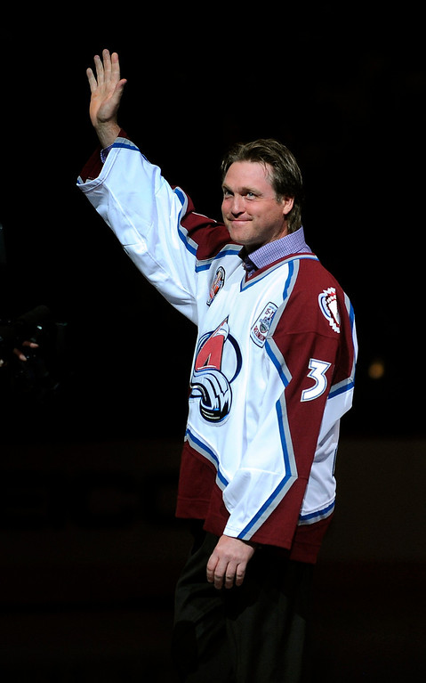 . Goalie Patrick Roy waves to the crowd during a ceremony honoring members of the 1995-1996 Stanley Cup winning squad before the game in 2010 at the Pepsi Center in Denver.  (Karl Gehring/The Denver Post)