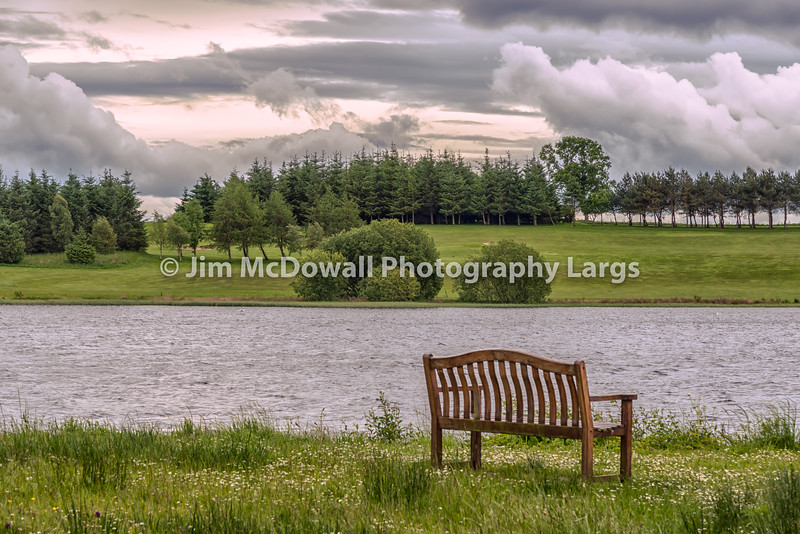 Piperdam Lake and an isolated chair in Scotland