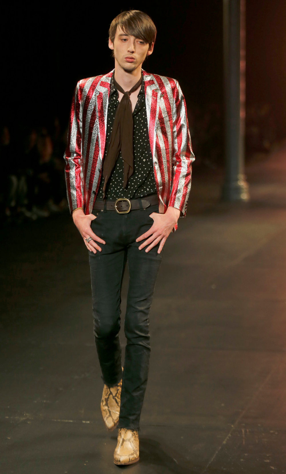 . A model wears a creation by French-born designer Hedi Slimane for Saint Laurent menís Spring-Summer 2015 fashion collection, presented in Paris, Sunday, June 29, 2014. (AP Photo/Jacques Brinon)