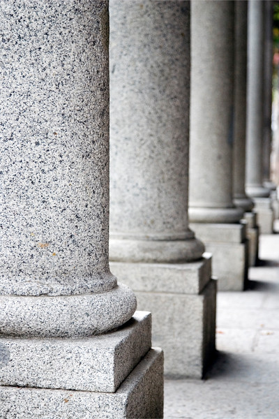 Graphic, abstract image of lined up granite columns