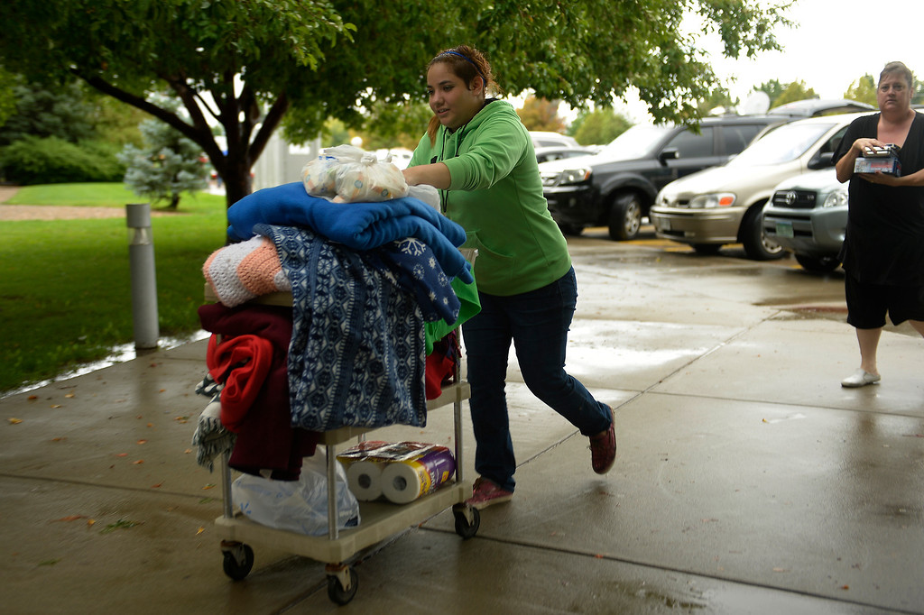 . 15 year old Elle Puente helping stock donations for rescued residents of Lyons being sheltered at the LifeBridge Christian Church in Longmont September 13, 2013 Longmont, Colorado. (Photo By Joe Amon/The Denver Post)