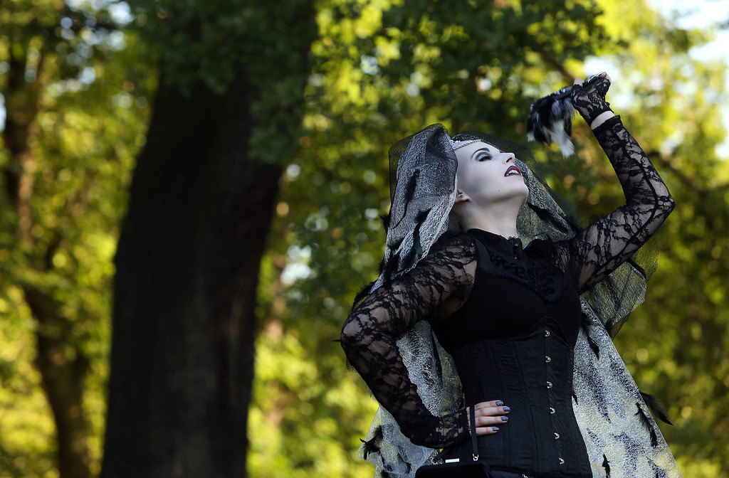 . A Gothic enthusiast jokes with her friends during a Victorian picnic during the annual Wave-Gotik-Treffen music festival on June 6, 2014 in Leipzig, Germany. (Photo by Adam Berry/Getty Images)