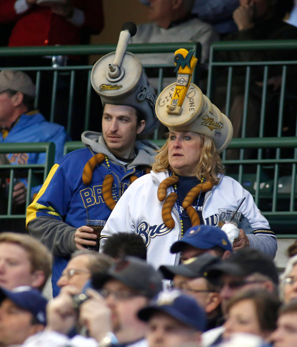 . Fans watch the start of opening day of baseball season as the Milwaukee Brewers take on the Colorado Rockies during the first inning in a MLB National League baseball game in Milwaukee, Wisconsin April 1, 2013. REUTERS/Darren Hauck