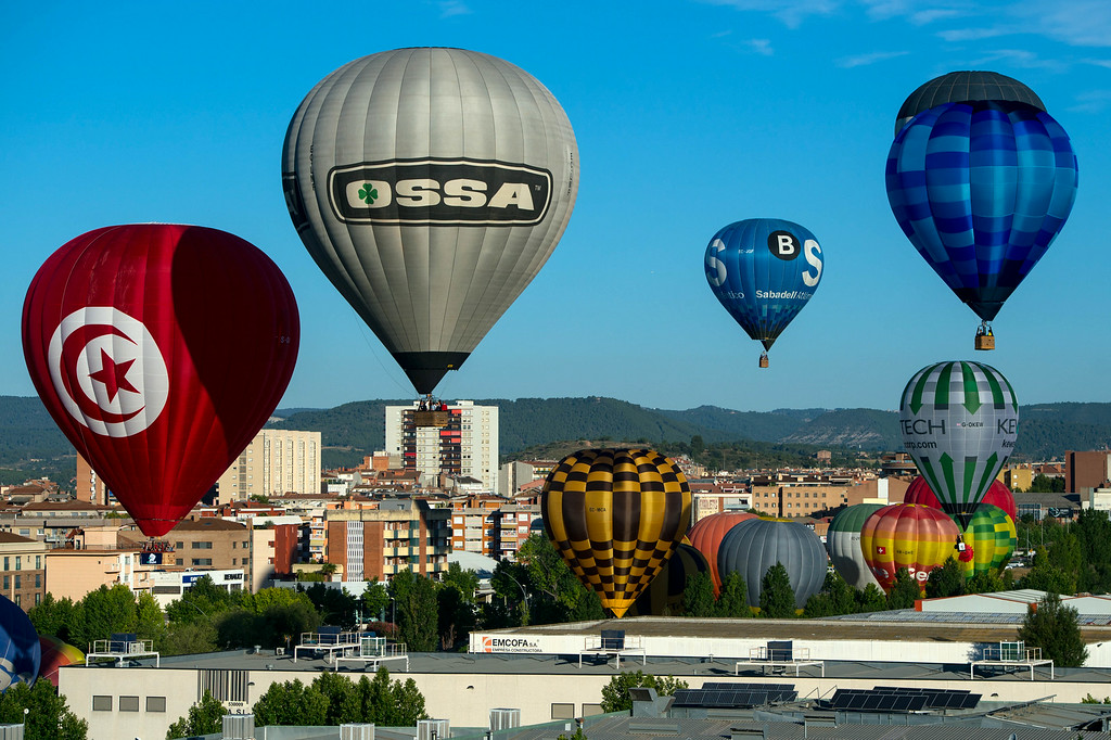 . Hot air balloons fly over Igualada during an early flight as part of the European Balloon Festival on July 10, 2014 in Igualada, Spain.  (Photo by David Ramos/Getty Images)