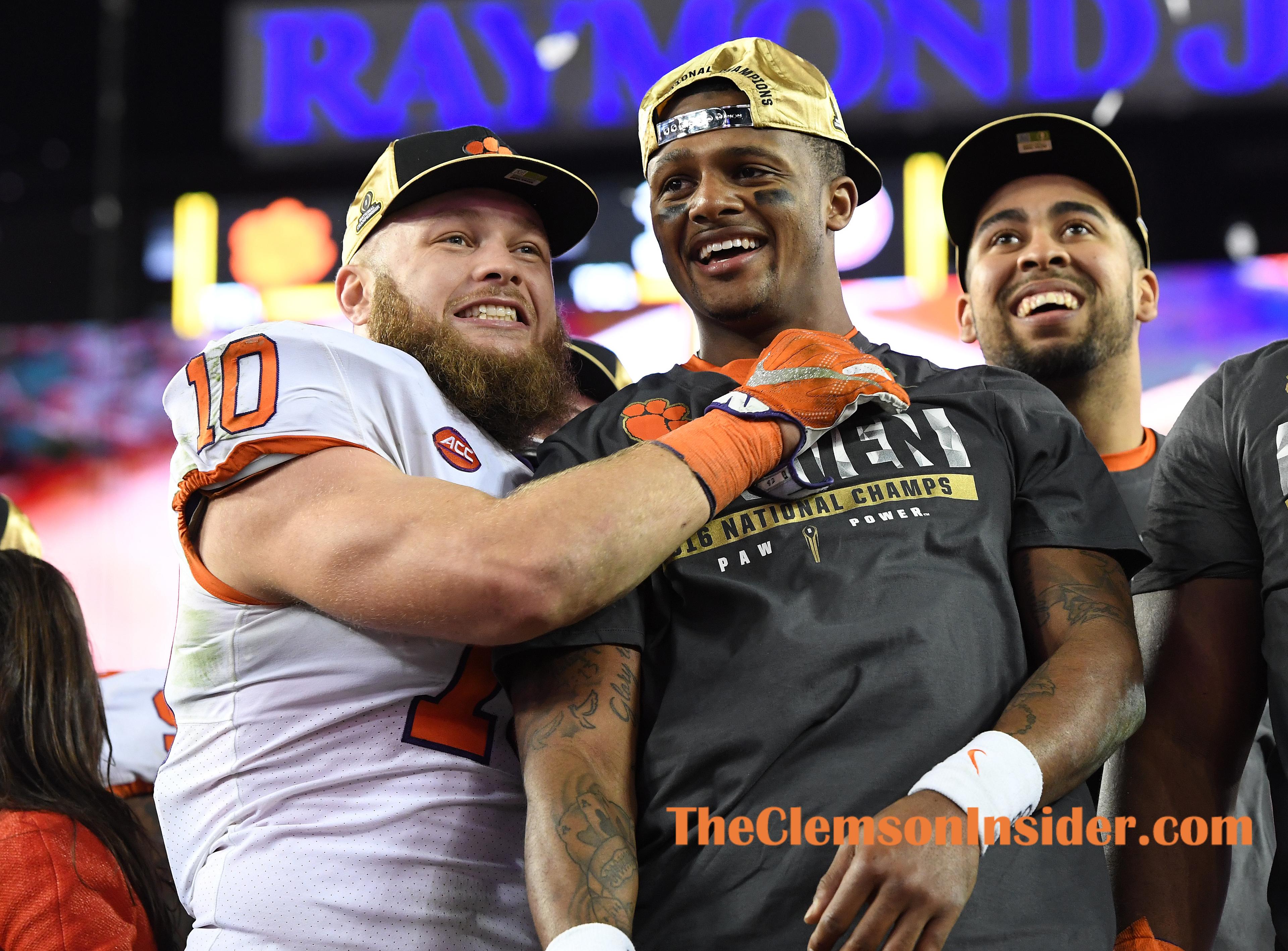 Clemson linebacker Ben Boulware (10) hugs quarterback Deshaun Watson (4) after the Tigers defeated Alabama 35-31 to win the National Championship at Raymond James Stadium in Tampa on Monday, January 9, 2017.