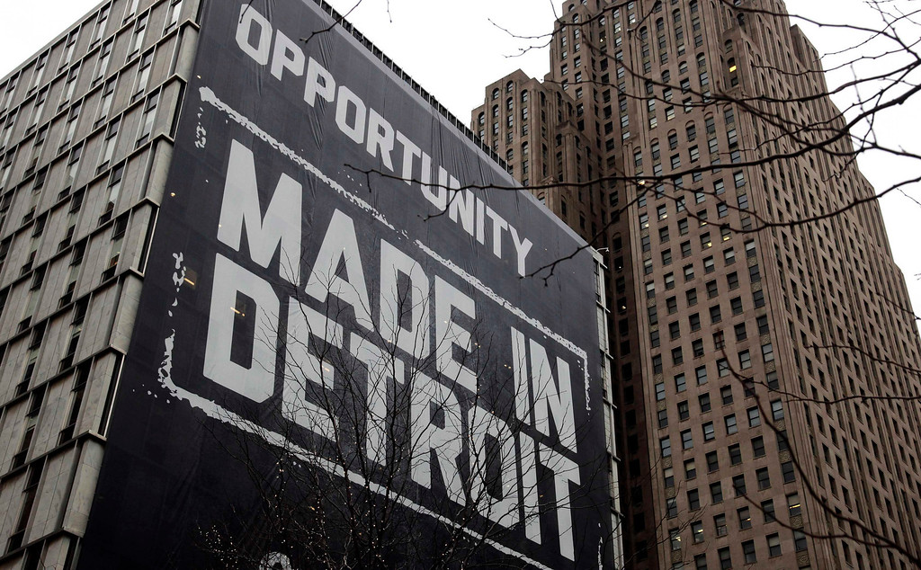 """. A large \""""Opportunity Made In Detroit\"""" banner is seen on the side of a building in downtown Detroit, Michigan in this January 30, 2013 file photo. Detroit filed the largest-ever municipal bankruptcy in U.S. history on July 18, 2013, marking a new low for a city that was the cradle of the U.S. automotive industry and setting the stage for a costly court battle with creditors. To match story USA-DETROIT/  REUTERS/Rebecca Cook/Files"""