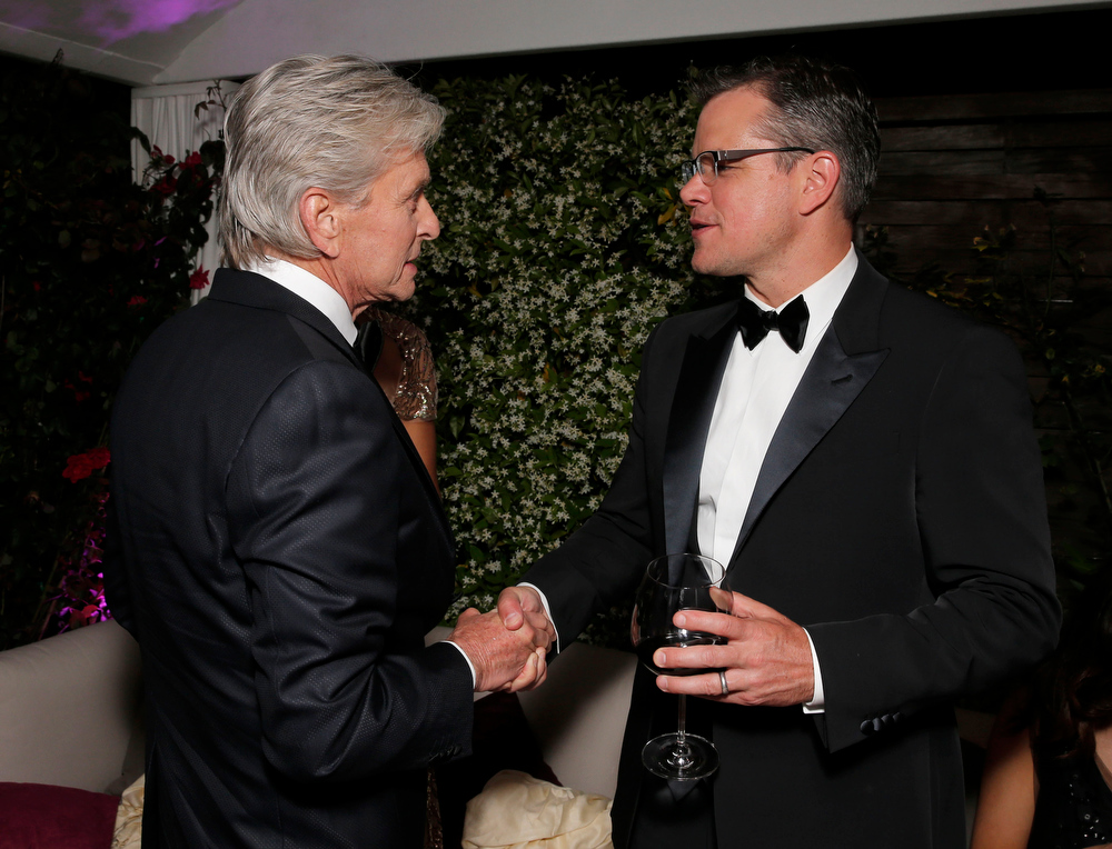 . Actors Michael Douglas and Matt Damon shake hands at the Behind the Candelabra after party at the 66th international film festival, in Cannes, southern France, Tuesday, May 21, 2013. (Photo by Todd Williamson/Invision/AP)