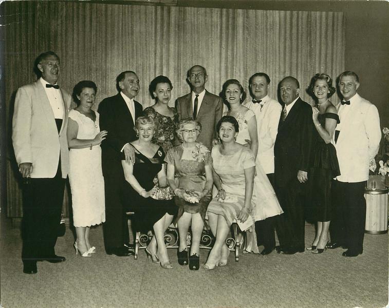 Kitty sitting far right. Billy 3rd from right 1957.jpg