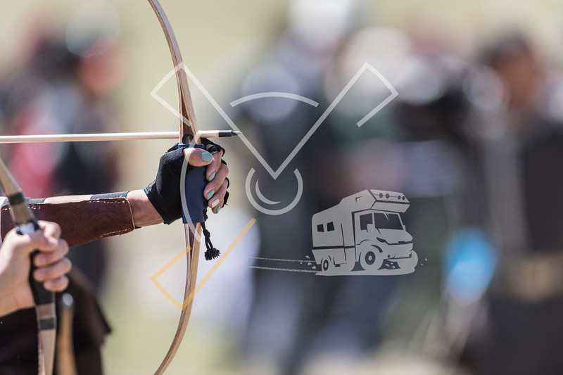 Detail of a female archer ready to shoot during an archering competition at the World Nomad Games 2018 in Kyrgyzstan.