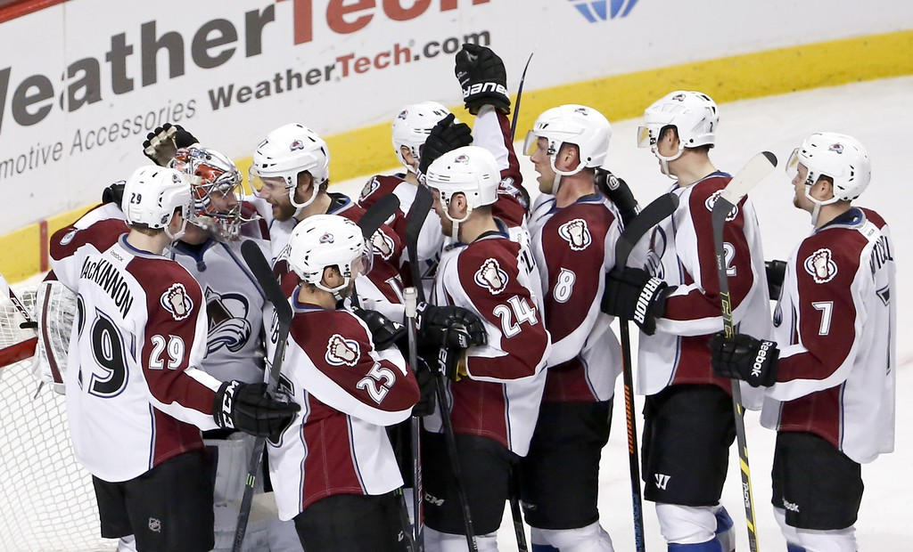. The Colorado Avalanche celebrates around goalie Semyon Varlamov (1) his 2-0 shutout of the Chicago Blackhawks after an NHL hockey game Tuesday, Jan. 6, 2015, in Chicago. (AP Photo/Charles Rex Arbogast)