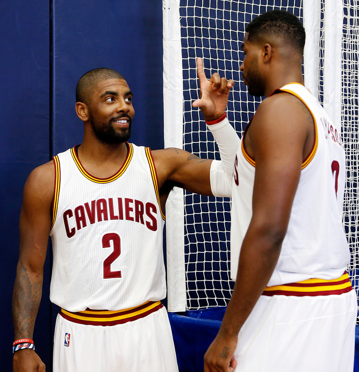 . Cleveland Cavaliers guard Kyrie Irving (2) and center Tristan Thompson talk after competing in a game of pop-a-shot during the NBA basketball team\'s media day, Monday, Sept. 26, 2016, in Independence, Ohio. (AP Photo/Ron Schwane)