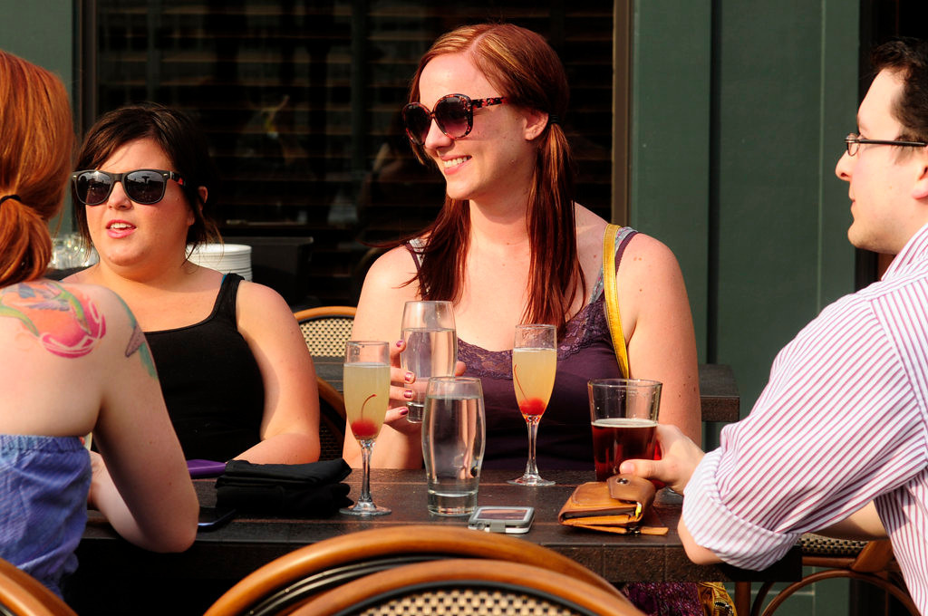 . Emily Gormanson, left, Kristin Hosch, Amanda Marlow and Jake Linscheid enjoy their drinks on the patio at Louis, on Cosetta\'s top floor in St. Paul in early May 2013. (Pioneer Press: Scott Takushi)