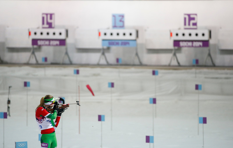 . Belarus\' Darya Domracheva shoots on her way to win the gold medal in the women\'s biathlon 10k pursuit, at the 2014 Winter Olympics, Tuesday, Feb. 11, 2014, in Krasnaya Polyana, Russia. (AP Photo/Felipe Dana)