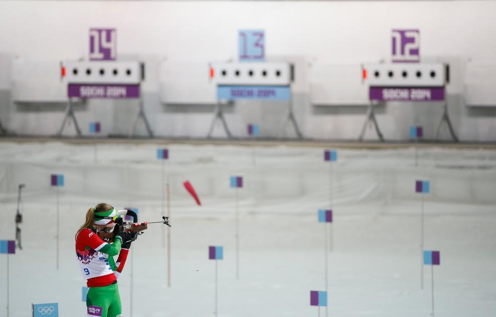 . Belarus\' Darya Domracheva shoots on her way to win the gold medal in the women\'s biathlon 10k pursuit, at the 2014 Winter Olympics, Tuesday, Feb. 11, 2014, in Krasnaya Polyana, Russia. (AP Photo/Felipe Dana)
