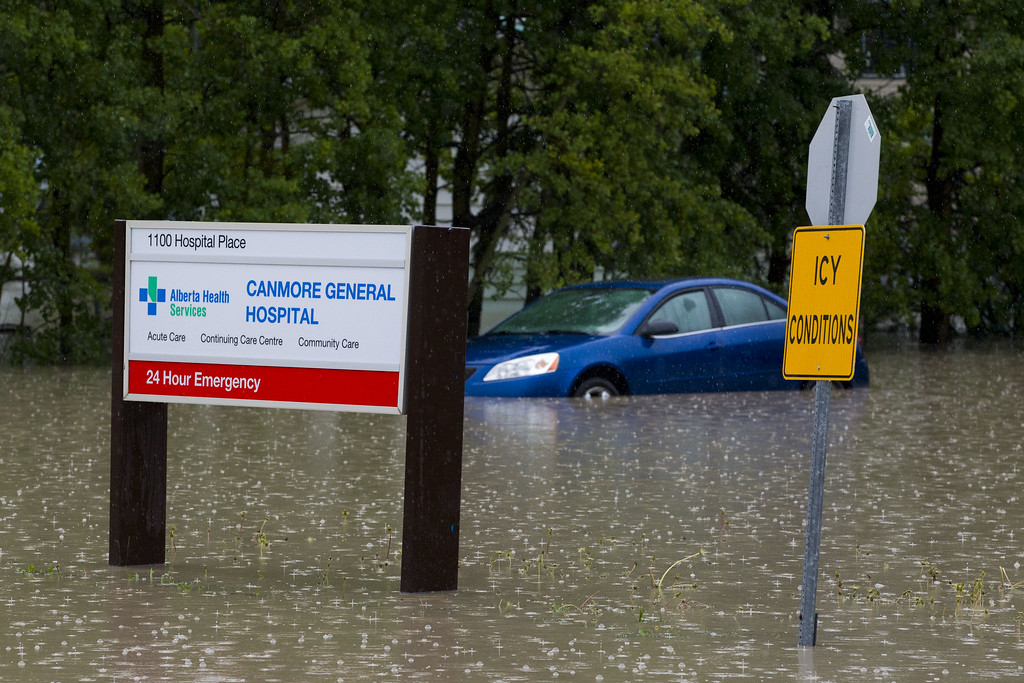. A car sits submerged by water outside the Canmore General Hospital due to heavy flooding June 21, 2013 in Canmore, Alberta, Canada. Widespread flooding caused by torrential rains washed out bridges and roads prompting the evacuation of thousnds.  (Photo by John Gibson/Getty Images)