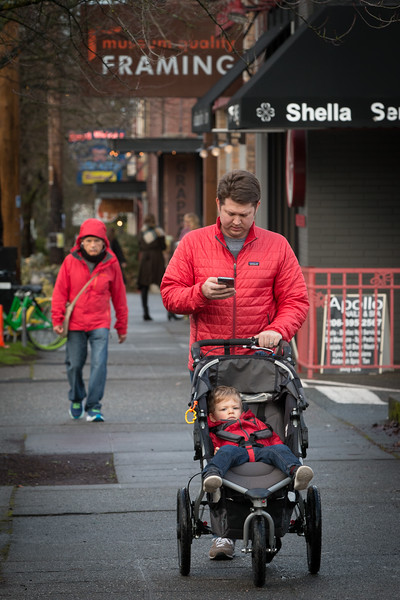 On Queen Anne Avenue in Seattle, a digitally distracted father takes his son for a stroll
