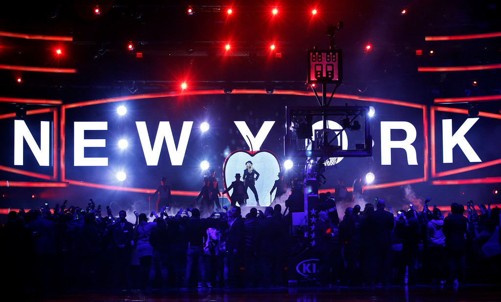 . Christina Aguilera, center, performs prior to the start of the NBA All-Star basketball game, Sunday, Feb. 15, 2015, in New York. (AP Photo/Kathy Willens)