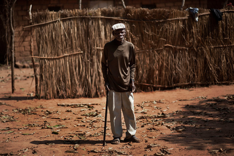 . Victor Keita, who said he was born in 1928, stands outside one of the many empty houses of his neighbors who have fled, in the town of Damara where pro-government forces are digging in against the rebel advance, about 70km (44 miles) north of the capital Bangui, Central African Republic Wednesday, Jan. 2, 2013. After troops under Bozize seized the capital in 2003 amid volleys of machine-gun and mortar fire, he dissolved the constitution and parliament, and now a decade later it is Bozize himself who could be ousted from power with rebels having seized more than half the country and made their way to the doorstep of the capital in less than a month. (AP Photo/Ben Curtis)