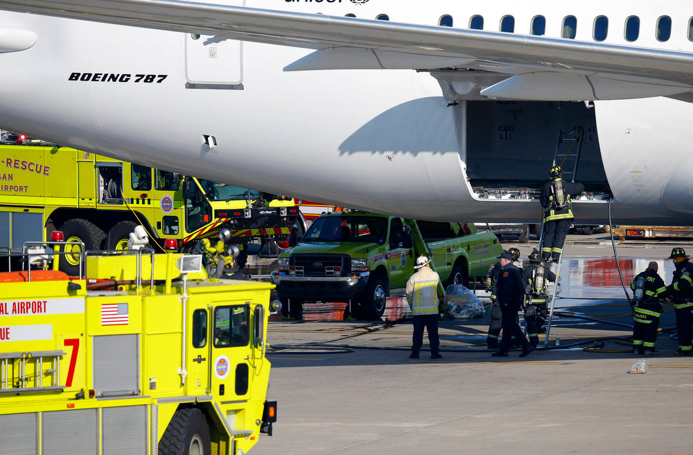 Description of . Firefighters climb into a rear cargo compartment of a Japan Airlines Boeing 787 Dreamliner that caught fire at Logan International Airport in Boston, Massachusetts in this January 7, 2013 file photograph. The U.S. Federal Aviation Administration said on January 16, 2013 it would temporarily ground Boeing Co's 787s after a second incident involving battery failures caused one of the Dreamliner passenger jets to make an emergency landing in Japan.    REUTERS/Brian Snyder/Files